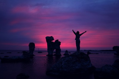 cheering woman in sunset