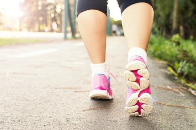 Tennis shoes walking on pavement